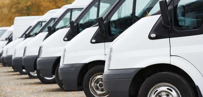 commercial delivery vans in row at parking place of transporting