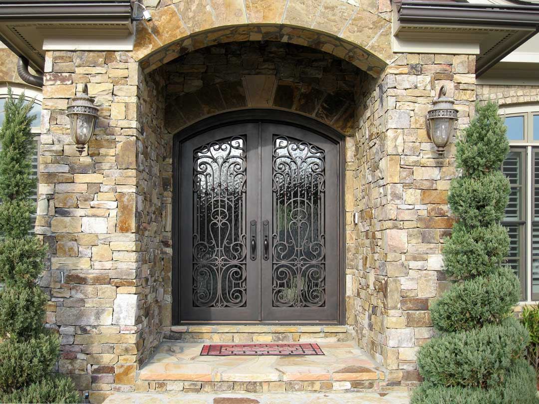 810 #8A7041 How Iron Doors Can Set Your Home Apart save image Arched Front Doors For Homes 44971080